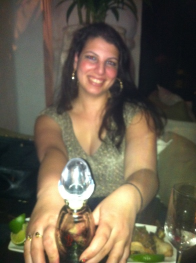 Here's me at Red O on my birthday with a phallic-shaped bottle of tequila.