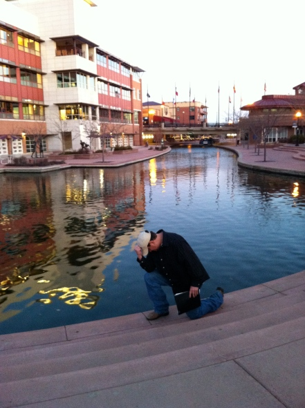 My favorite picture of Dave - tebowing at the Pueblo Riverwalk.
